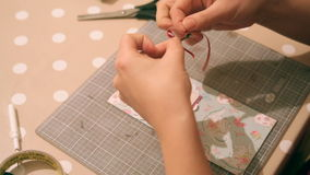Hands of a woman crafting and scrap-booking christmas cards.  stock video