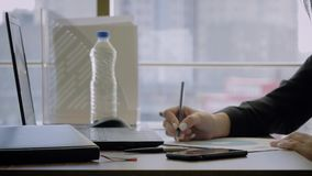 Hands Woman Creative Director Sitting At Desk Makes Notes With Pencil On Chart stock video