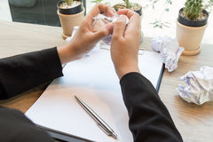 Hands of woman crumple sheets of Resume at the desk, mistake res Stock Images