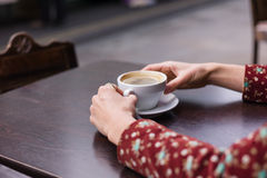 Hands of woman with cup of coffee outside Royalty Free Stock Images