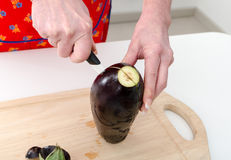 Hands of woman cutting eggplant Royalty Free Stock Photo