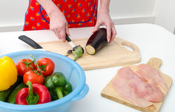 Hands of woman cutting eggplant Stock Photography