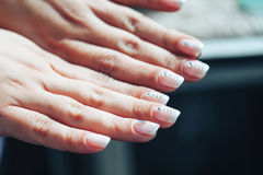 Hands of a Woman with Decorated Nails Stock Image