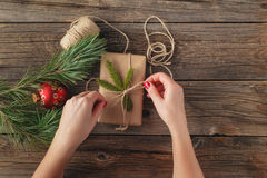 Hands of woman decorating Christmas gift box Royalty Free Stock Image