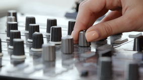 Hands of woman Dj play music on the mixing console stock footage