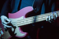 The hands of woman with electric bass stock photography