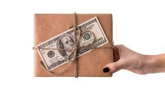 Hands of woman holding gift box with 100 dollar bill. On white background Royalty Free Stock Photo