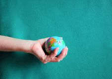 Hands of woman holding globe royalty free stock images