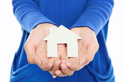 Hands of woman holding paper house. Portrait of Hands of woman holding white paper house Stock Photography