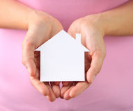 Hands of woman holding paper house Stock Images