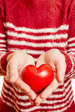 Hands of a woman holding a red heart of love Stock Photos