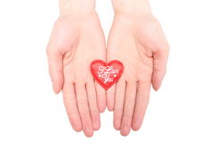 Hands of woman holding red heart. White background Royalty Free Stock Images