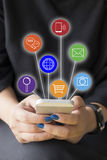 Hands woman holding smart phone and communication line icons Stock Image