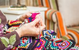 Hands of woman knitting a vintage wool quilt Royalty Free Stock Photography