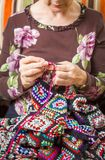 Hands of woman knitting a vintage wool quilt Royalty Free Stock Photo