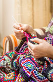 Hands of woman knitting a vintage wool quilt Royalty Free Stock Images
