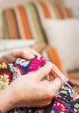 Hands of woman knitting a vintage wool quilt Stock Photography