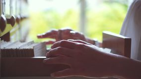 Hands of woman checking cards at library. Hands of woman at library flipping through cards looking for information stock footage