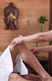 Hands of woman making massage at feets Stock Image