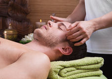 Hands of woman making massage to a man Stock Photos