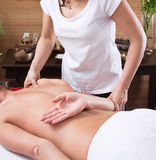 Hands of a woman making massage Stock Image