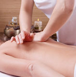 Hands of a woman making massage on a womans back Stock Images
