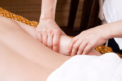Hands of a woman making massage Royalty Free Stock Image