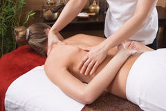 Hands of a woman making massage Stock Images