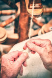 Hands of a woman making traditional wool spinning Stock Image