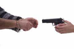 Hands of woman and man with gun and handcuffs Royalty Free Stock Photography
