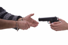 Hands of woman and man with gun and handcuffs Royalty Free Stock Image