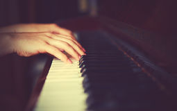 Hands of woman pianist on piano keyboard Royalty Free Stock Images