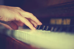 Hands of woman pianist on piano keyboard Stock Photography