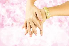 Hands of woman pink white manicured on nails. Bright pink bokeh blur backround. Stock Photography