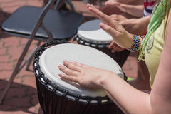 Hands of a woman playing a drum closeup Royalty Free Stock Images