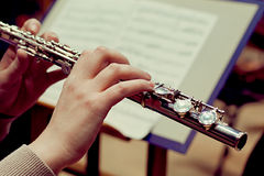Hands of a woman playing a flute Royalty Free Stock Image