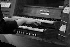 Hands of a woman playing the organ Royalty Free Stock Image