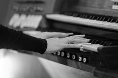 Hands of a woman playing the organ Stock Image