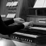 Hands of a woman playing the organ Royalty Free Stock Images