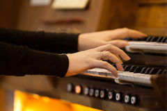 Hands of a woman playing the organ Stock Photo