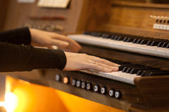 Hands of a woman playing the organ Stock Photography