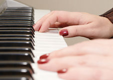 Hands of a woman playing piano Stock Photo