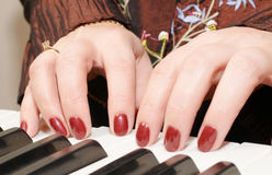 Hands of a woman playing piano Royalty Free Stock Photos