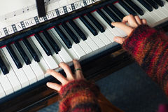 Hands of woman playing piano Stock Image