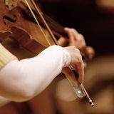Hands of a woman playing the violin Stock Photos