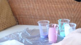 Hands woman prepares and paints paints for drawing a picture of fluid art 4k stock footage
