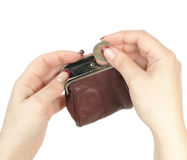 Hands of the woman putting a coin in a purse Royalty Free Stock Photography