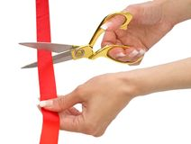 Hands of woman with scissors and red line isolated Stock Image