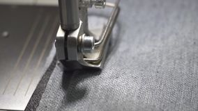 Hands of a woman seamstress at work on a sewing machine. Close up stock video footage