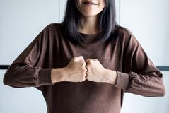 Hands of woman show strength teamwork,Fist bump and putting her hand royalty free stock images